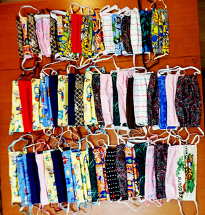 53 cloth face masks laid out on a table