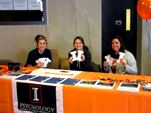Psychology Leaders sitting at a I Love Illinois Week booth