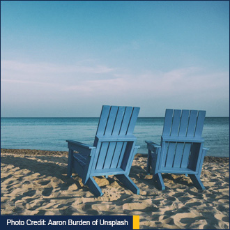 Photo Credit: Aaron Burden of Unsplash - picture of two chairs on the beach