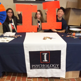 "Psychology Leaders at the ""I Love Illinois Week"" event table."