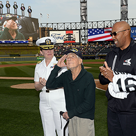 Leon Cooper, center, was honored at a Chicago White Sox game for his efforts to recover missing World War II soldiers.